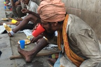 Migrant worker in New Delhi, eating his breakfast